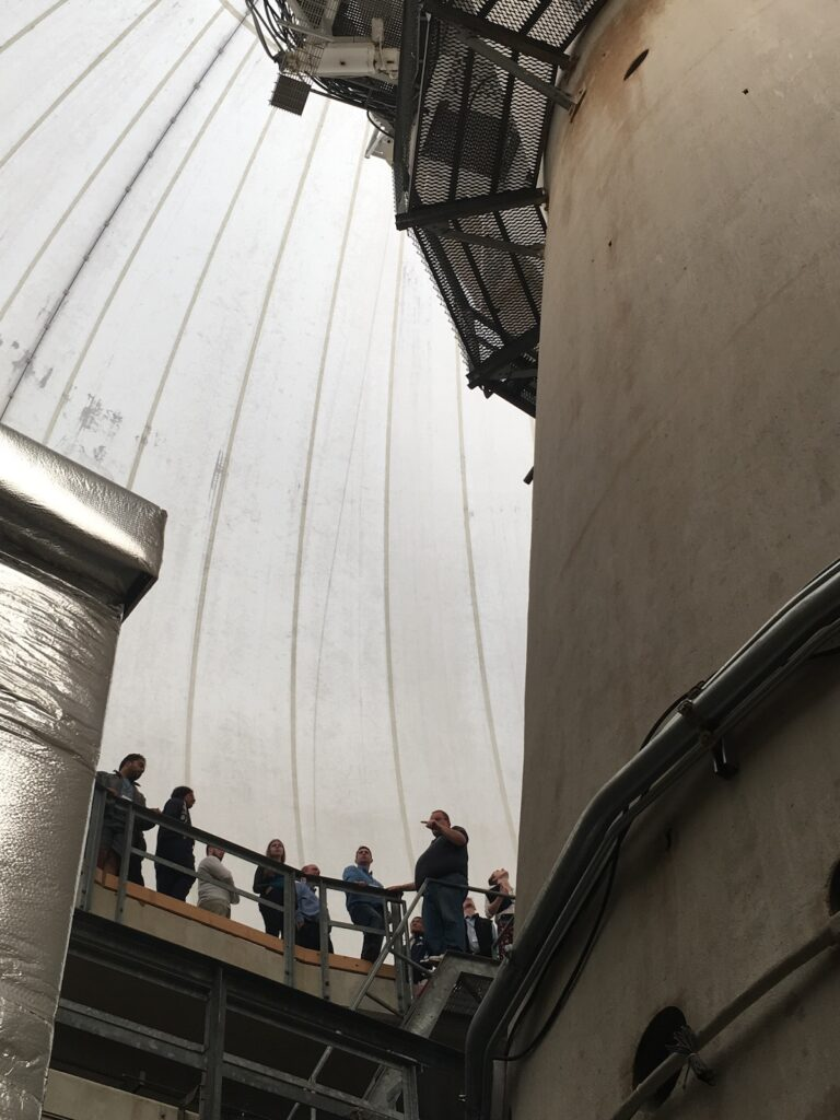 People inside the Westford Radio Telescope for a tour