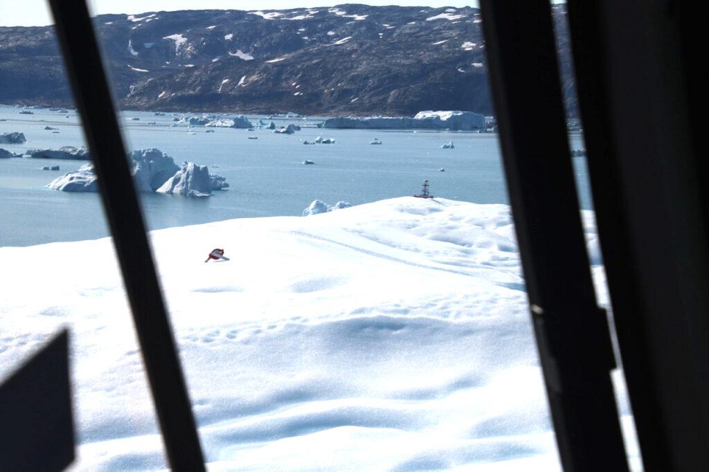 GPS receiver deployment on an iceberg in Sermilik Fjord, Greenland